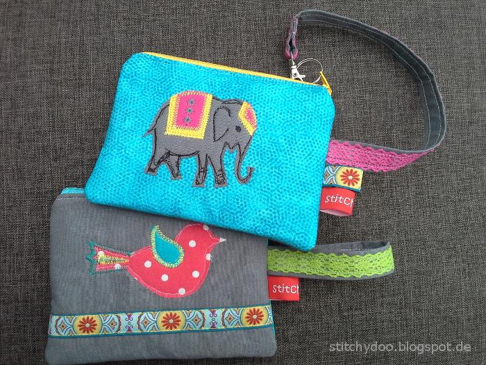 Handgelenktasche Karo (Taschenspieler) mit Elefant und Vogel Applikation